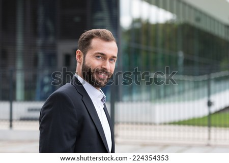 Good Looking Smiling Middle Age Man in Corporate Attire Outside Building - stock photo