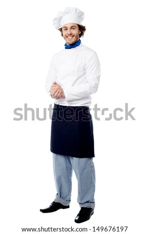 Good looking young cook posing confidently - stock photo