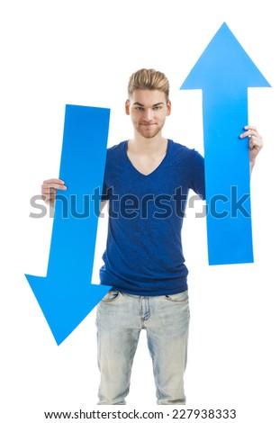Good looking young man holding a blue arrow, isolated on a white background - stock photo