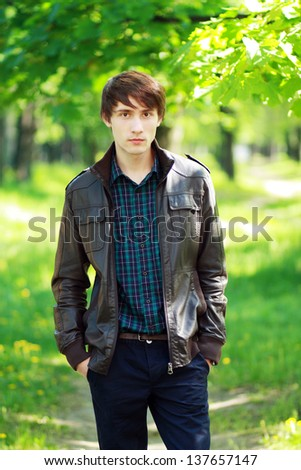 good looking young man outdoors - stock photo