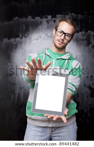 Good Looking Young Nerd Smart Guy Man Using Tablet Computer - stock photo