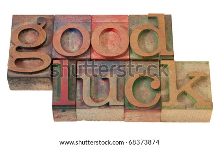 good luck- phrase  in vintage wooden letterpress printing blocks, stained with color inks, isolated on white - stock photo