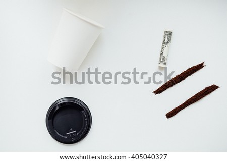 good morning, alternative drugs concept,  ground coffee like cocaine powder in two lines on a white background with cup and Rolled Up Bill, humor and fun - stock photo