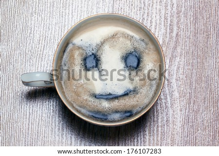 good morning. coffee cup with painted smiling face - stock photo