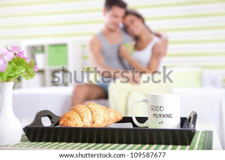 good morning,  happy couple in bed with breakfast in focus - stock photo