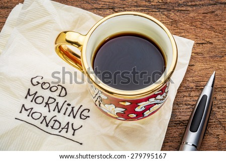 Good morning, Monday - handwriting on a napkin with a cup of coffee - stock photo