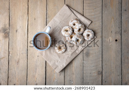 Good morning or Have a nice day Merry Christmas message concept - blue cup of frothy coffee gingerbread white chocolate cookies - stock photo