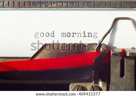 Good morning sign on old typrewriter machine  - stock photo