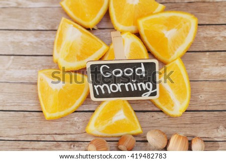 Good morning. Tasty morning. Orange morning. Orange pieces on wooden background.  - stock photo