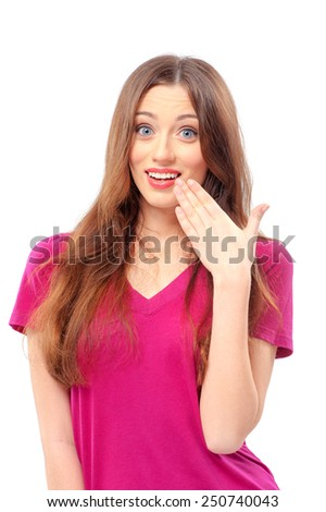 Good news! Surprised beautiful young smiling caucasian woman looking at camera and touching face with hand while standing isolated on white - stock photo
