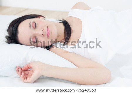 Good night: portrait of a young woman sleeping on a pillow - stock photo