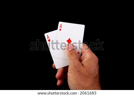 good poker hand with two aces - stock photo