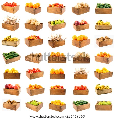 Good set on a theme harvesting. Set of vegetables and fruit in wooden boxes. On a white background. - stock photo