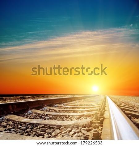 good sunset over railroad closeup - stock photo