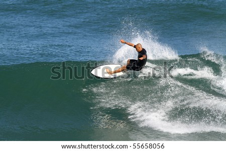 good surfer in action - stock photo