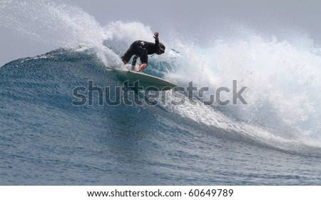 good surfer in action on a beautiful wave - stock photo