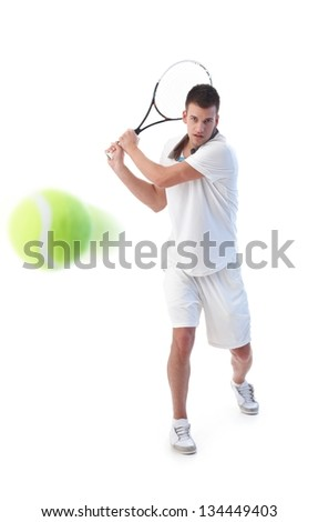 Goodlooking tennis player prepared for backhand stroke, - stock photo