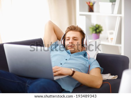Goodlooking young man relaxing at home - stock photo