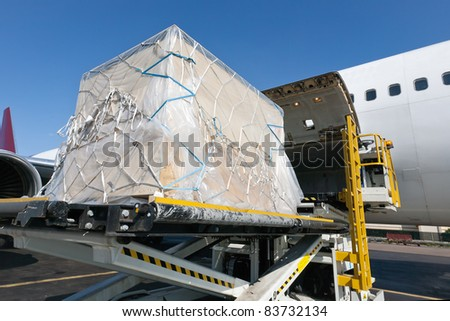 Goods are loaded on the plane - stock photo