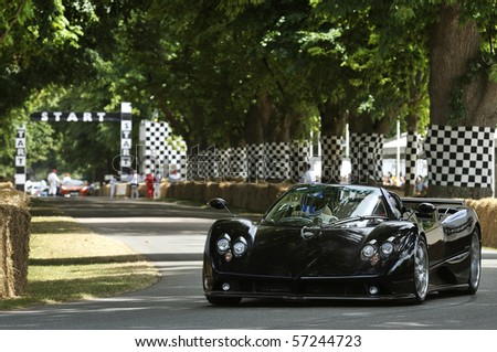 GOODWOOD, UNITED KINGDOM - JULY 3: Carbon bodied Pagani Zonda drives up the hill at the Goodwood Festival of Speed in the United Kingdom on July 3, 2010 in Goodwood, UK - stock photo