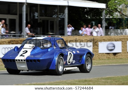GOODWOOD, UNITED KINGDOM - JULY 3: Classic Corvette race car drives up the hill at the Goodwood Festival of Speed in the United Kingdom on July 3, 2010 in Goodwood, UK - stock photo