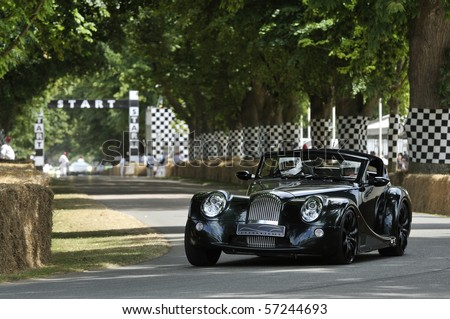 GOODWOOD, UNITED KINGDOM - JULY 3: Morgan drives up the hill at the Goodwood Festival of Speed in the United Kingdom on July 3, 2010 in Goodwood, UK - stock photo