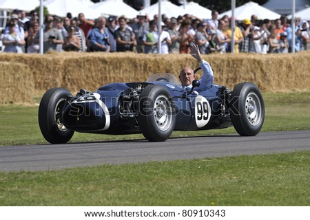 GOODWOOD, UNITED KINGDOM - JULY 1: Sir Stirling Moss drives up the hill at the Goodwood Festival of Speed in the United Kingdom on July 1, 2011 in Goodwood, UK - stock photo