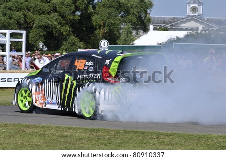 GOODWOOD, UNITED KINGDOM - JULY 1: World Rally Driver Ken Block drives up the hill at the Goodwood Festival of Speed in the United Kingdom on July 1, 2011 in Goodwood, UK - stock photo