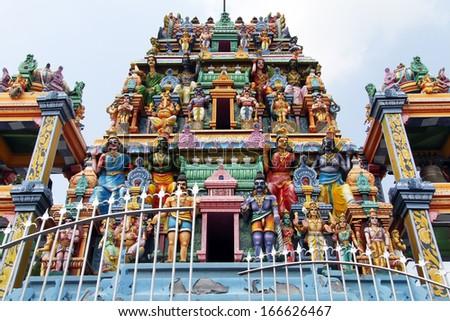 Gopuram with statues of hindu gods in Negombo, Sri Lanka  - stock photo