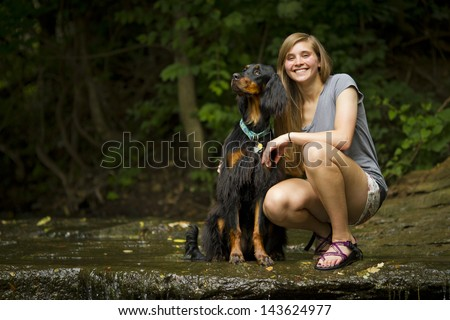 Gordon setter with young pretty girl. - stock photo