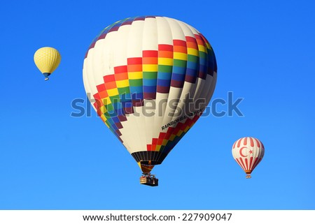 GOREME, TURKEY - OCTOBER 21, 2014: Hot Air Balloon Flights over the spectacular and breathtaking lunarscape of Cappadocia.   - stock photo