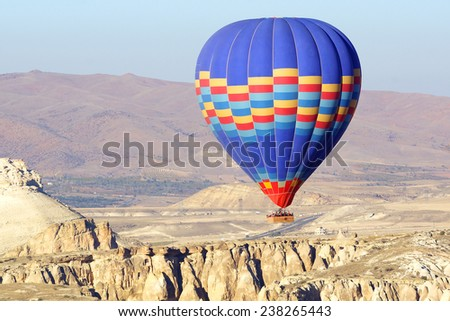 GOREME, TURKEY - OCTOBER 21, 2014: Hot Air Balloon Flights over the spectacular and breathtaking lunarscape of Cappadocia. Hot air ballooning is very popular thanks to the amazing landscapes.  - stock photo