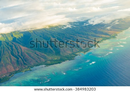 Gorgeous aerial view on the Maui island from the sea plane. Beautiful nature. - stock photo