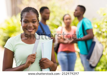 gorgeous afro american college student looking at the camera - stock photo