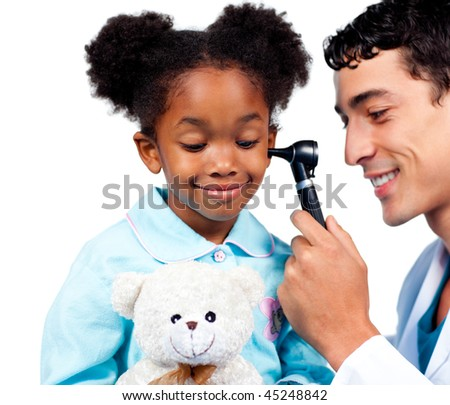 Gorgeous afro-american little girl at a medical visit holding a teddy bear against on a white background - stock photo