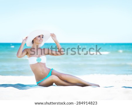 Gorgeous and beautiful young girl relaxing on a summer beach - stock photo