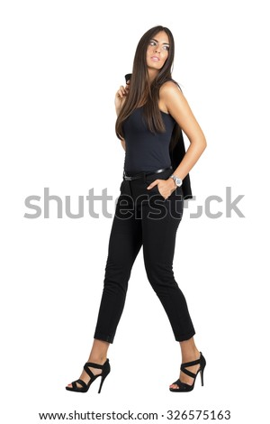 Gorgeous attractive Latin woman carrying jacket of the shoulder looking away. Full body length portrait isolated over white studio background.  - stock photo