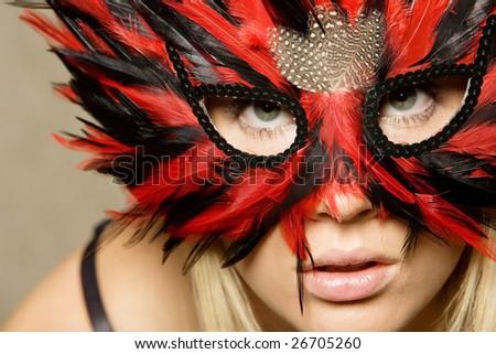 Gorgeous blond girl wearing mask - stock photo