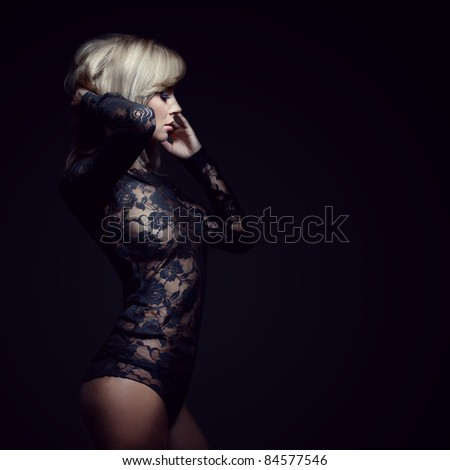 gorgeous blonde in lace dress, isolated on black, studio shot, space for copy - stock photo