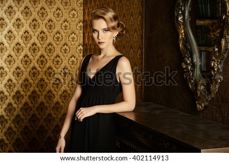 Gorgeous blonde woman in a luxurious classic interior. Beauty, fashion. - stock photo