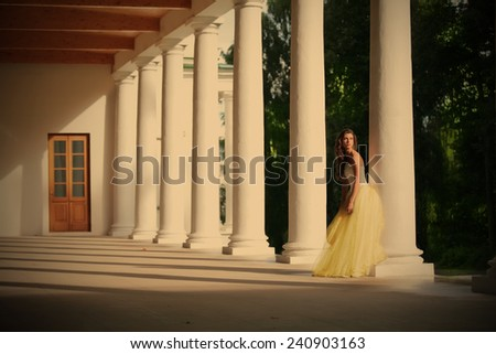 gorgeous bride amongst colonnades of the old-time building, instagram image style - stock photo