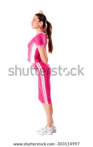 Gorgeous brunette warming up and doing some exercise. Isolated over white background - stock photo