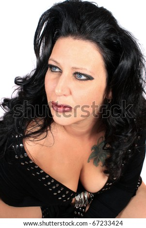 Gorgeous busty and  glamorous brunette woman wearing black  on a white background - stock photo