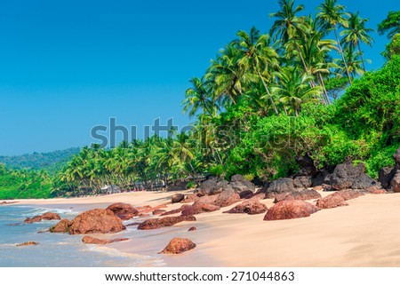 gorgeous deserted tropical beach with the hot sun - stock photo