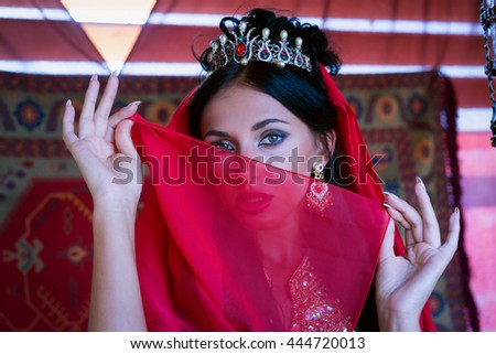 gorgeous eyes of young indian woman in traditional clothing with bridal makeup and jewelry. Beautiful bride traditionally dressed Outdoors in India. bollywood dancer in Sari. Arabian bellydancer - stock photo
