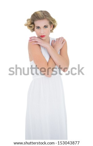 Gorgeous fashion blonde model posing with hands on shoulders on white background - stock photo