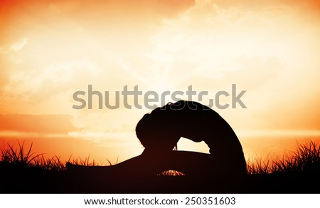 Gorgeous fit blonde in seated forward bend pose against orange sunrise - stock photo