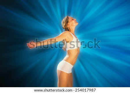 Gorgeous fit blonde standing with arms out against abstract background - stock photo