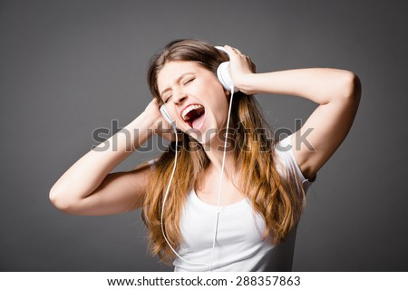 Gorgeous Girl listening to music    - stock photo