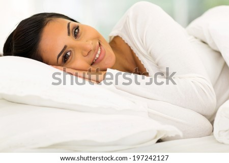 gorgeous girl lying in comfy bed - stock photo